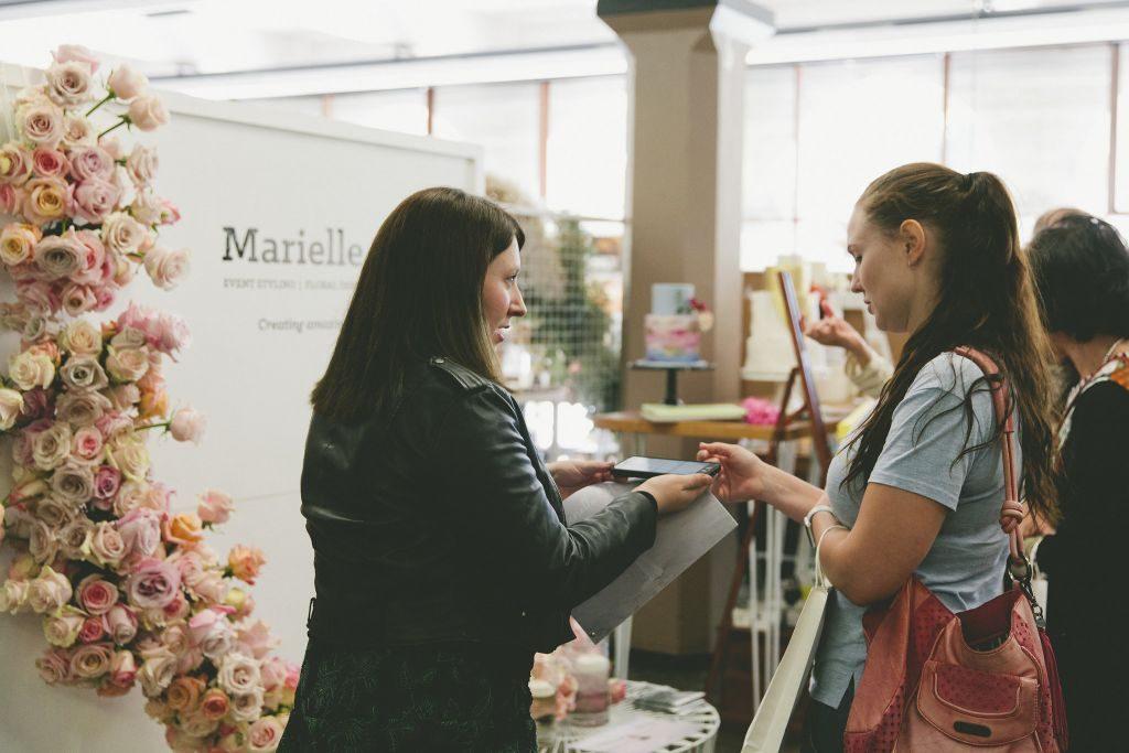 wedding vendors talking to customers