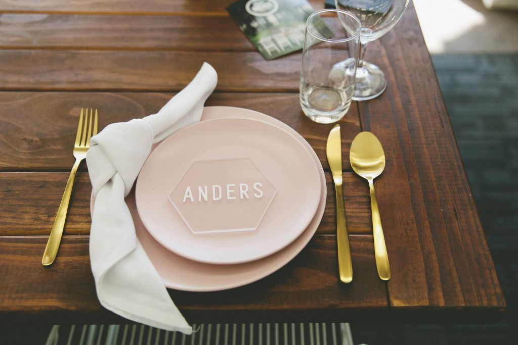 Pink plate with gold cutlery