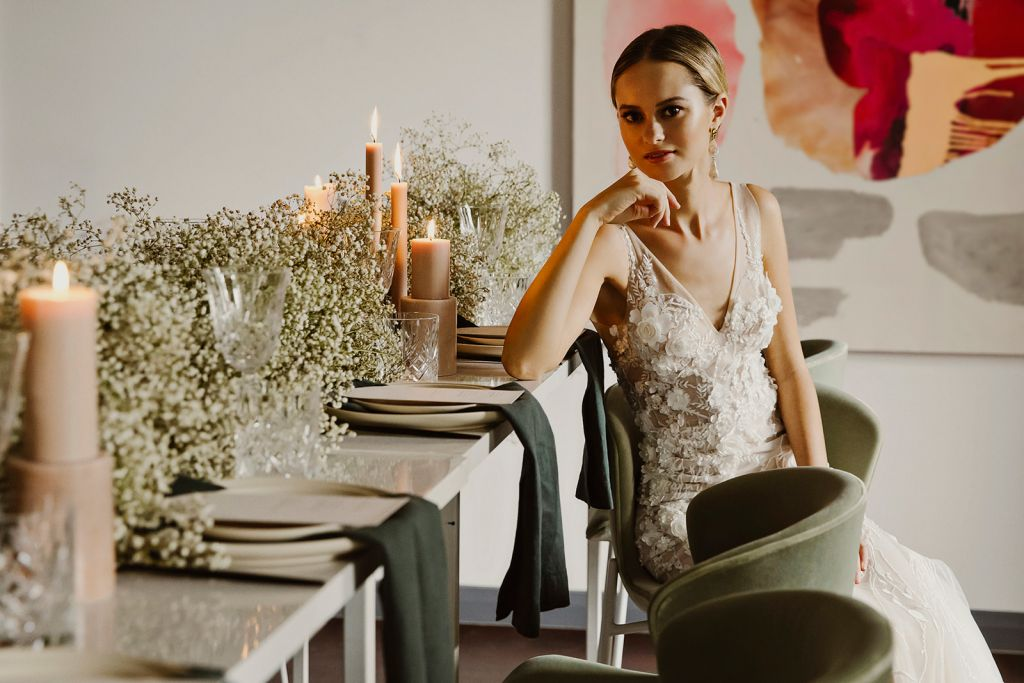 model sitting at high table