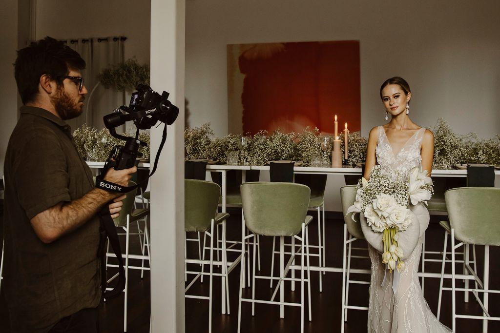 Model getting filmed