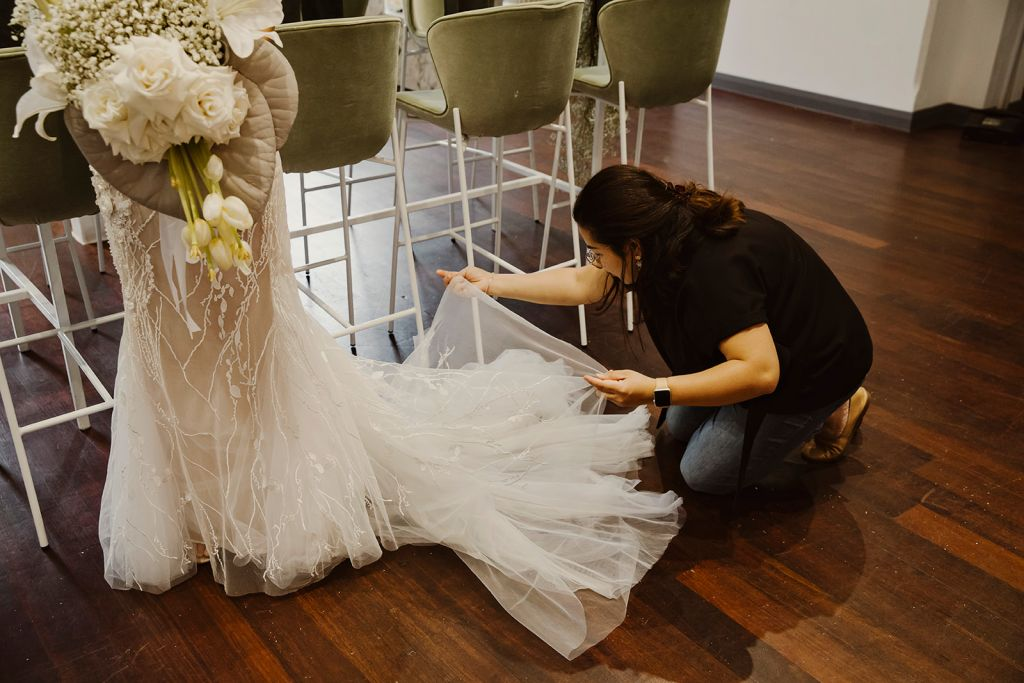 Dress designer fixing dress