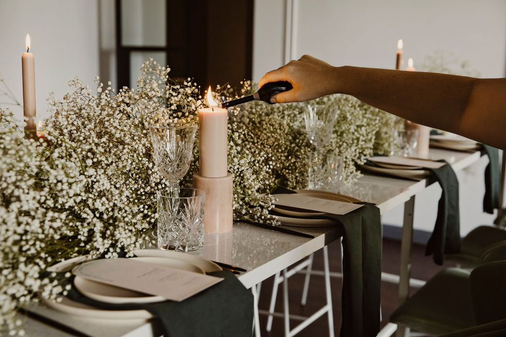 Wedding Stylist lighting candle